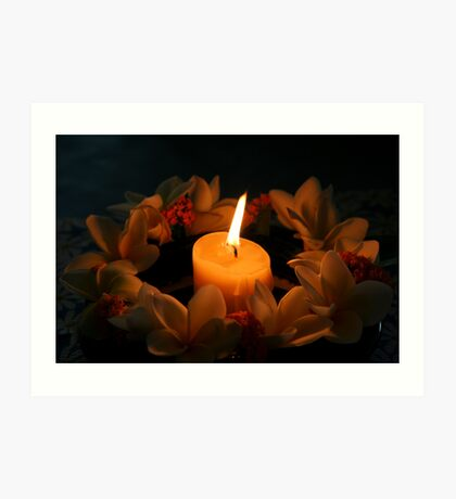 Candle surrounded by frangipanis Art Print