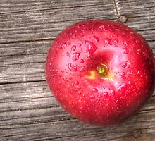Apple with water drops on table 3 by AnnArtshock
