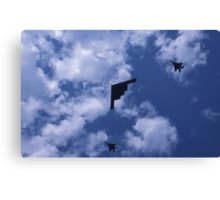 Stealth bomber with fighter escort Canvas Print
