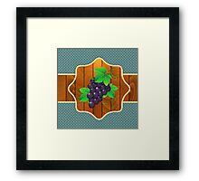 Grapes on a wooden background Framed Print