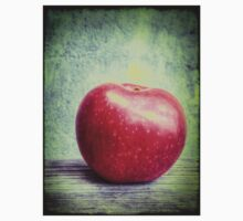 Red apple on grunge background 4 Kids Clothes