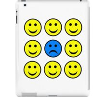 Sad Smiley Face in a Crowd of Happy Smilies iPad Case/Skin