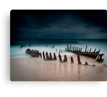 A beach with water Canvas Print