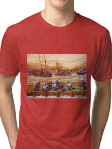 HOCKEY GAME IN THE VILLAGE CANADIAN WINTER SCENE PAINTING BY CANADIAN ARTIST CAROLE SPANDAU Tri-blend T-Shirt