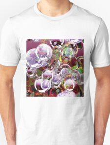 The hope is an iridescent bubble which colors fleetingly the life. T-Shirt