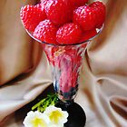 Rasberries in a glass by Rodica Nelson