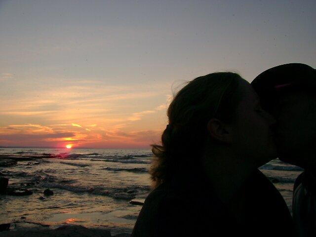 Kiss at sunset by Robert Lake