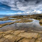 Irish rockpool with reflected sky by Kevin Hart