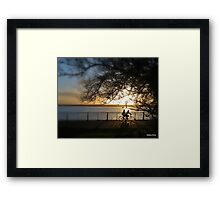 Cycling at sunset  Framed Print
