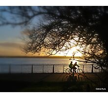 Cycling at sunset  Photographic Print