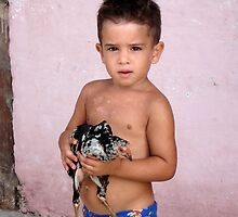 Little Cuban boy with chicken by Bill Knapp