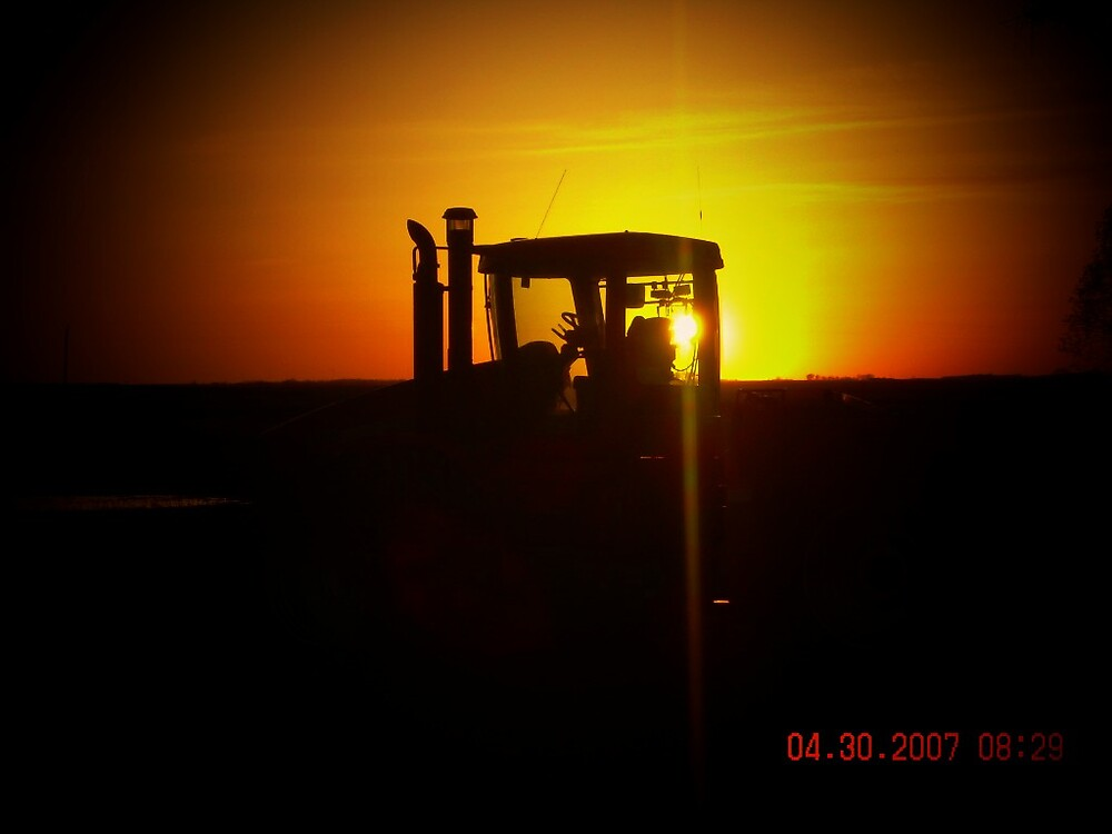 tractor in sunset by Jaclyn Clemens