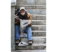 Catching Up On the News Photographic Print