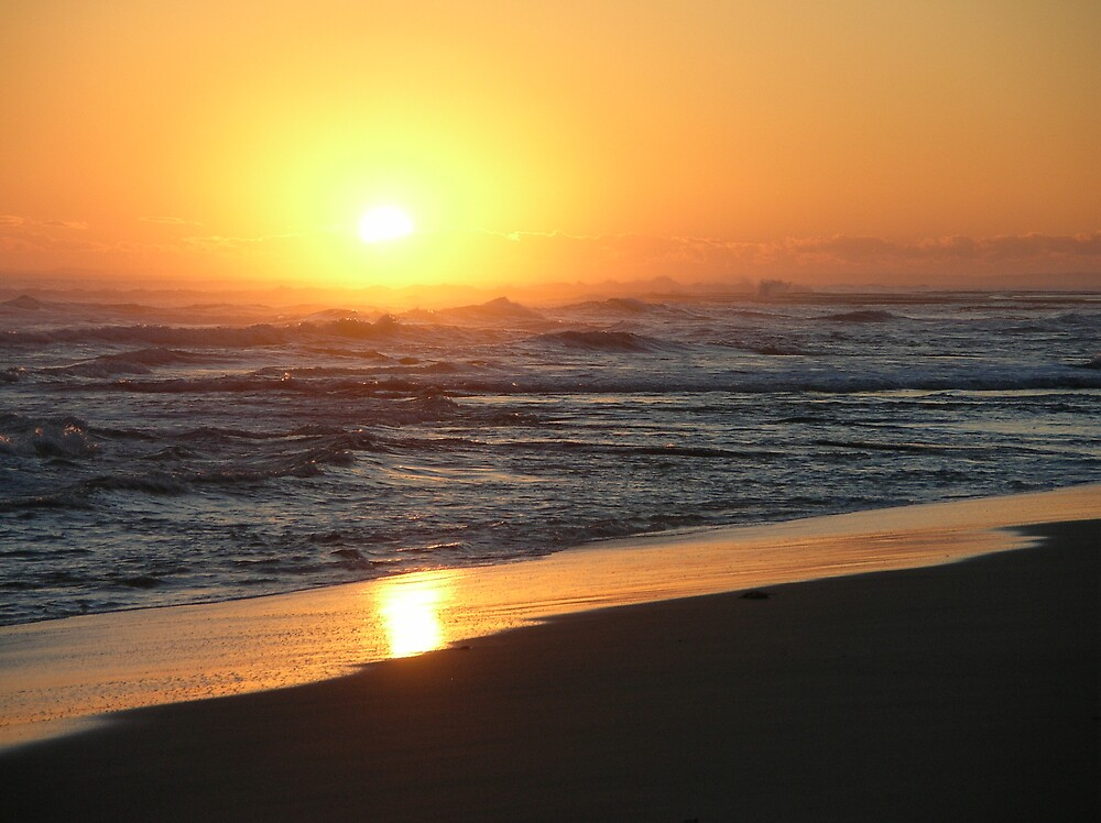Ocean beach at Sundown by avocado