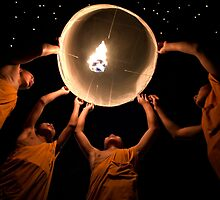 Young Monks releasing a lantern - Thailand by Daniel Nahabedian