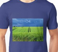 Green grass field with dramatic beautiful sky background Unisex T-Shirt