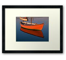 Small dinghy dory floating in the water Framed Print