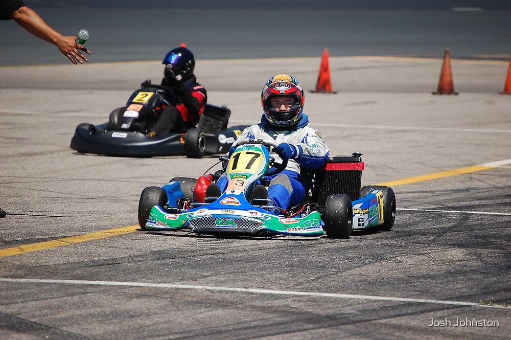 Racer entering garage by Josh Johnston