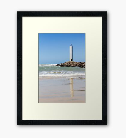 Torres lighthouse in a windy day and blue sky Framed Print
