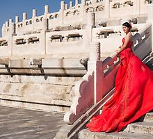 Young bride in red dress in China art photo print by ArtNudePhotos