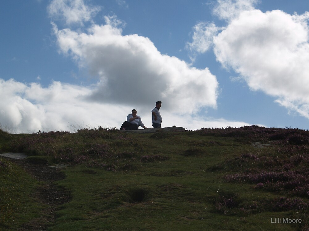 people on top of a hill  by Lilli Moore