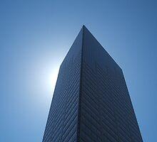 The sun hidden behind a building by theokojak