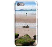 lone girl walking near unusual mud banks iPhone Case/Skin