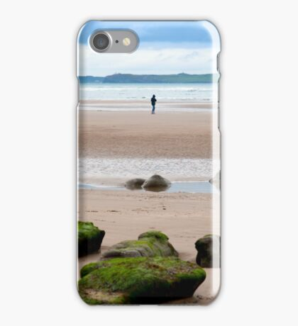 lone girl walking near unusual mud banks iPhone Case/Skin