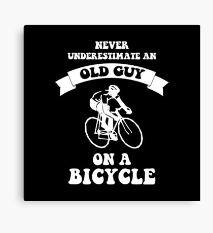 NEVER UNDERESTIMATE AN OLD GUY ON A BICYCLE Canvas Print
