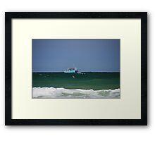 Boat at sea Framed Print