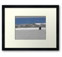 Looking at the ocean Framed Print