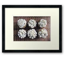 beautiful homemade cupcakes with decorative white creamy frosting flowering top.  food art.  Framed Print