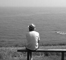 Man on a bench by John Morton