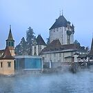 Oberhofen castle floating in the mist by Hercules Milas