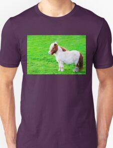 White chestnut pony horse in green grass field T-Shirt
