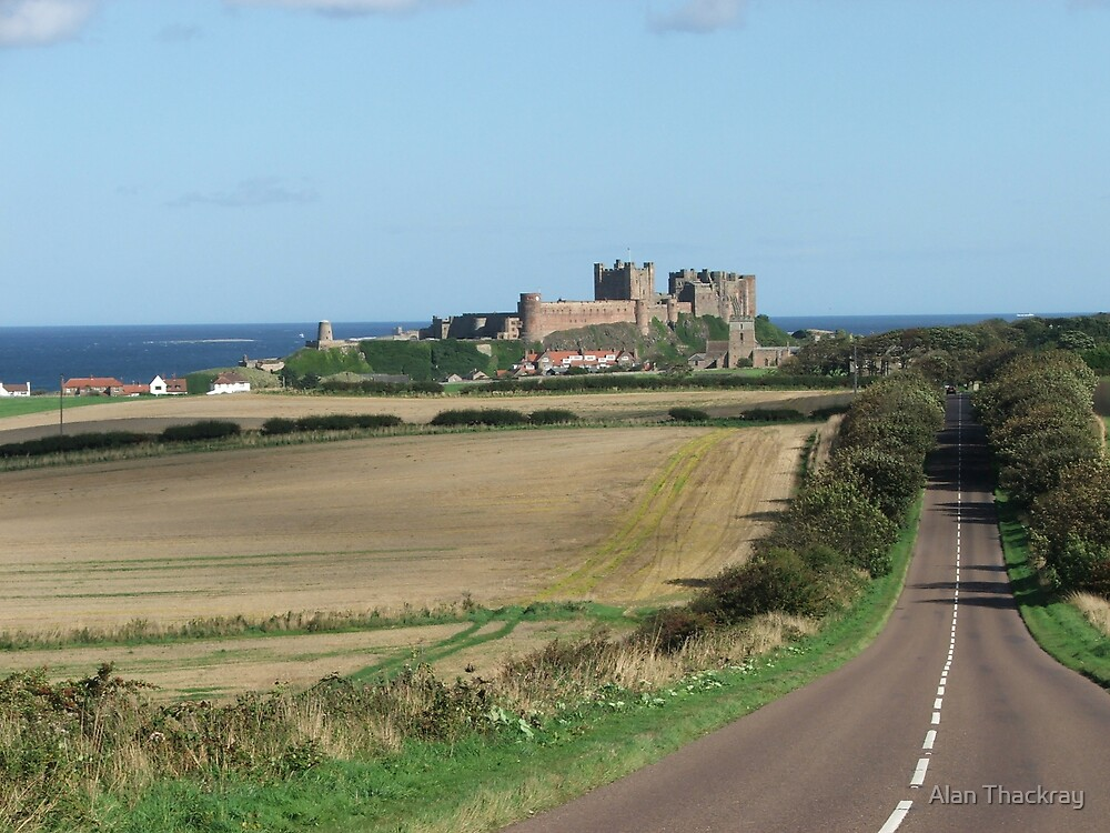 Bamburgh Castle and village by Alan Thackray