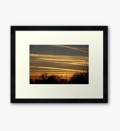 Winter vapour trails at sunset Framed Print