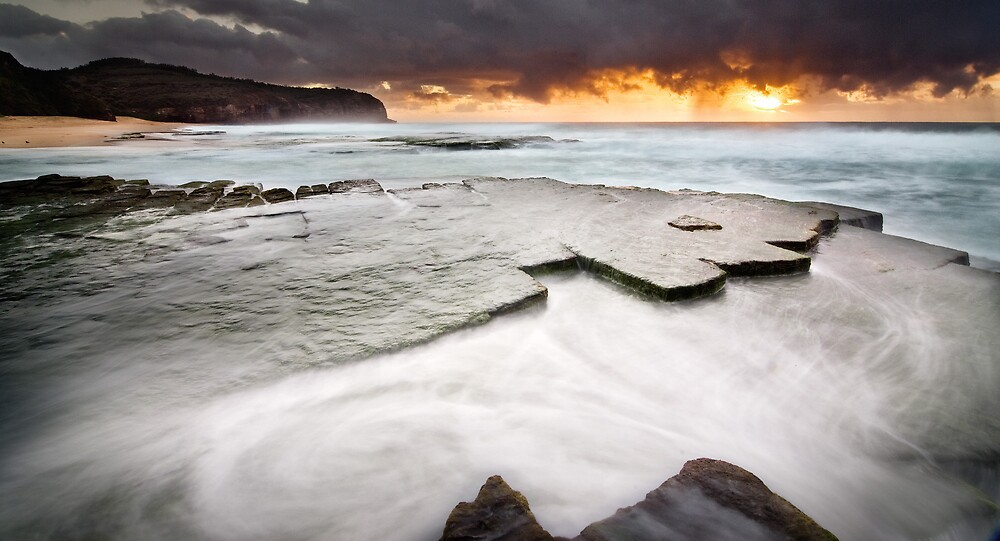 Waves Breaking Over Rocks At Dawn by Brent Pearson