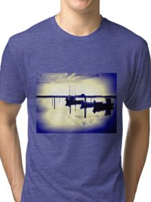 Magical reflection of a small dinghy dory boats Tri-blend T-Shirt