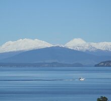 Lake Taupo Central North Island NZ and Snow capped Mountains by DavmarPhoto