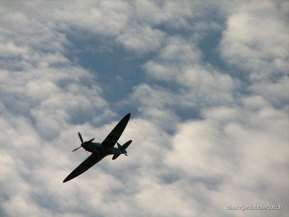 plane in the clouds by daantjedubbledutch