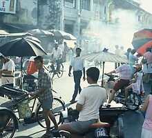 Busy street in Penang by Martin  Mullen