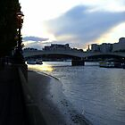 Sunset over Waterloo Bridge and the River Thames, London by Joanna Clark