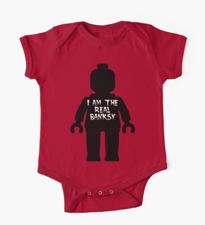 """Black Minifig with """"I am the Real Banksy"""" slogan by Customize My Minifig One Piece - Short Sleeve"""
