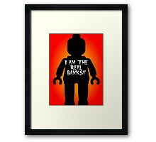"""Black Minifig with """"I am the Real Banksy"""" slogan by Customize My Minifig Framed Print"""