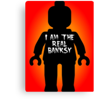 """Black Minifig with """"I am the Real Banksy"""" slogan by Customize My Minifig Canvas Print"""