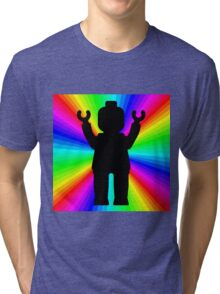 Black Minifig in front of Rainbow Tri-blend T-Shirt