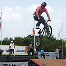 BMX Rider Catching Air by John Gilluley