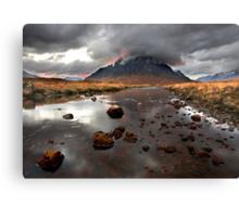 Sun sets behind Buachaille Etive Mor at Glencoe Scotland Canvas Print