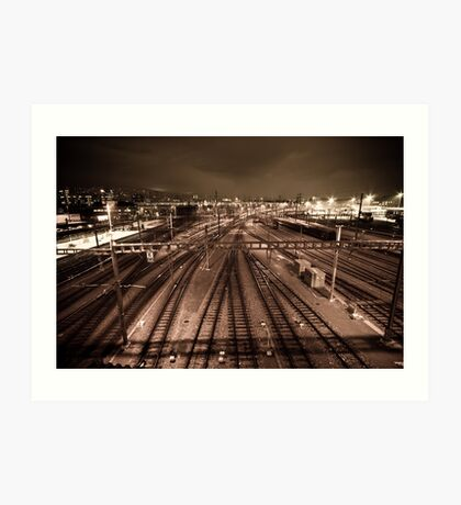 Train tracks in sepia by night. Art Print